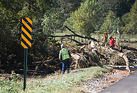 NWA Democrat-Gazette/CHARLIE KAIJO Workers look at a downed tree, Monday, October 7, 2019 at a road closure on Wagon Wheel Rd. and 56th Street in Springdale.