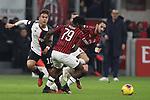 Paulo Dybala of Juventus threads the ball past Franck Kessie of AC Milan during the Coppa Italia match at Giuseppe Meazza, Milan. Picture date: 13th February 2020. Picture credit should read: Jonathan Moscrop/Sportimage