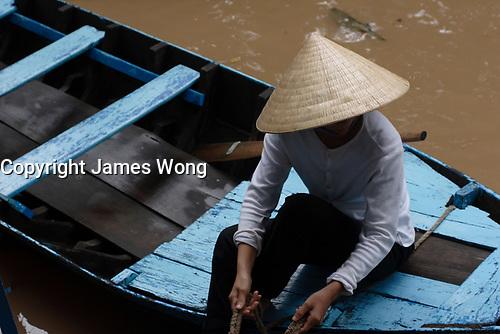 Mekong River<br /> , Vietnam - 2007 File Photo -<br /> <br /> Mekong Delta woman, on fishing boat.<br /> <br /> <br /> <br /> <br /> photo : James Wong-  Images Distribution