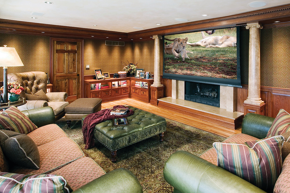 Masculine Family Room With Projection Screen Over Fireplace