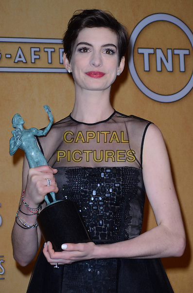 Anne Hathaway (wearing Giambattista Valli).Pressroom at the 19th Annual Screen Actors Guild Awards held at The Shrine Auditorium, Los Angeles, California, USA..27th January 2013.SAG SAGs half length dress black sleeveless sheer tulle bodice embroidered skirt award trophy winner .CAP/ADM/TW.©Tonya Wise/AdMedia/Capital Pictures.