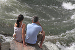 Man and woman sitting and resting along Boulder Creek, Boulder, Colorado. .  John offers private photo tours in Denver, Boulder and throughout Colorado. Year-round Colorado photo tours.