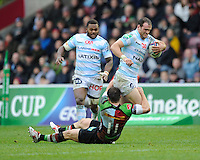 Jamie Roberts of Racing Metro 92 is tackled by Sam Smith of Harlequins during the Heineken Cup match between Harlequins and Racing Metro 92 at the Twickenham Stoop on Sunday 15th December 2013 (Photo by Rob Munro)