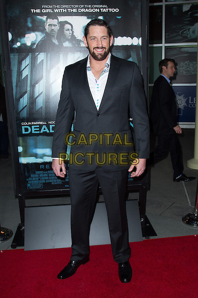 Wade Barrett.The premiere of FilmDistricts's 'Dead Man Down' at ArcLight Hollywood, Hollywood, California, USA..February 26th, 2013.full length black suit blue shirt beard facial hair .CAP/ADM/JS.©John Salangsang/AdMedia/Capital Pictures.