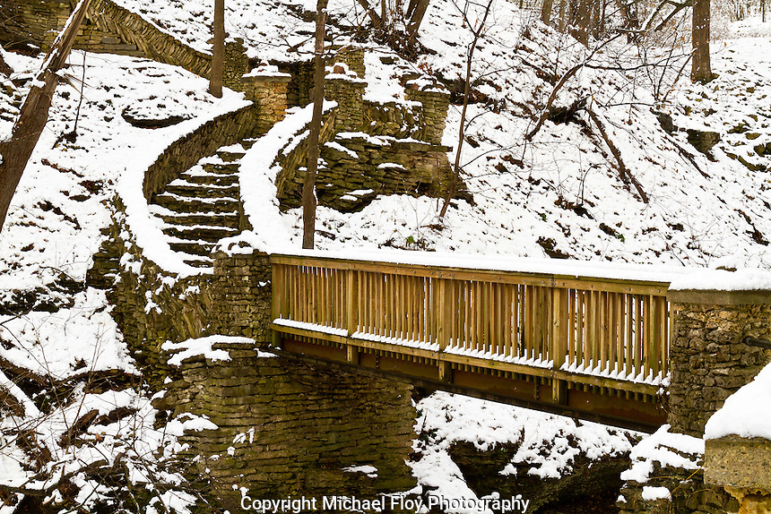Phelps Park Foot Bridge along hiking trail in the Broadway-Phelps Park Historic District Decorah, Iowa in winter.