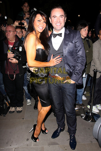 LIZZIE CUNDY & GUEST.The Nokia N8 short film 'The Commuter' premiere during the London Fillm Festival. Aqua, Argyll Street, London, England .October 25th, 2010.full length dress black strapless look closer nipple flashing lizzy side.CAP/AH.©Adam Houghton/Capital Pictures.