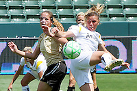 Camille Abily #20 of Los Angeles Sol battles Erika Dos Santos #20 of FC Gold Pride for a loose ball during their match at Home Depot Center on April 19, 2009 in Carson, California.