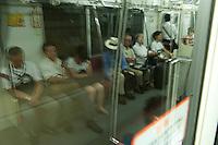 Underground landscape reflection view of people sitting in a Tokyo subway car following the 311 Tohoku Tsunami in Tokyo, Japan  © LAN