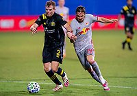 16th July 2020, Orlando, Florida, USA;  Columbus Crew defender Chris Cadden (2) runs with the ball as New York Red Bulls midfielder Alex Muyl (19) defends during the MLS Is Back Tournament between the Columbus Crew SC versus New York Red Bulls on July 16, 2020 at the ESPN Wide World of Sports, Orlando FL.
