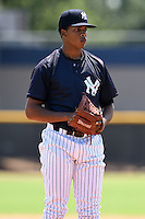 GCL Yankees 1 pitcher Simon De la Rosa (61) gets ready to deliver a pitch during the first game of a doubleheader against the GCL Braves on July 1, 2014 at the Yankees Minor League Complex in Tampa, Florida.  GCL Yankees 1 defeated the GCL Braves 7-1.  (Mike Janes/Four Seam Images)