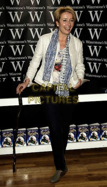 """EMMA THOMPSON .Book singing for """"Nanny McPhee And The Big Bang"""", Waterstone's Picadilly, London, England..March 6th 2010.full length walking stick cane jeans grey gray shoes flats flat blue scarf checked check beige cream jacket.CAP/CJ.©Chris Joseph/Capital Pictures."""