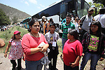Activists stand up as state policemen block the Humanitarian caravan to San Juan Copala on the highway Juxtlahuaca-San Juan Copala, June 08, 2010, as the state authorities try to stop the caravan. More than four hundred people make their way to San Juan Copala's Autonomous Municipality, carrying 35 tons of food to the Triqui people of San Juan Copala sieged by the paramilitaries of the ruling party PRI's Union para el Bienestar Social de la Region Triqui (UBISORT). Photo by Heriberto Rodriguez