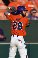 Right fielder Seth Beer (28) of the Clemson Tigers bats in a game against the William and Mary Tribe on February 16, 2018, at Doug Kingsmore Stadium in Clemson, South Carolina. Clemson won, 5-4 in 10 innings. (Tom Priddy/Four Seam Images)