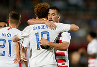GEORGETOWN, GRAND CAYMAN, CAYMAN ISLANDS - NOVEMBER 19: Josh Sargent #19 of the United States celebrates his goal with team mate Daniel Lovitz #5 during a game between Cuba and USMNT at Truman Bodden Sports Complex on November 19, 2019 in Georgetown, Grand Cayman.