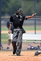 Umpire Edwin Moscoso asks the field umpire for assistance during the first game of a doubleheader between the GCL Braves and GCL Yankees 1 on July 1, 2014 at the Yankees Minor League Complex in Tampa, Florida.  GCL Yankees 1 defeated the GCL Braves 7-1.  (Mike Janes/Four Seam Images)