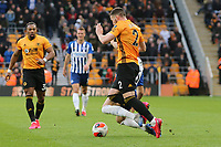 Alireza Jahanbakhsh of Brighton & Hove Albion and Matt Doherty of Wolverhampton Wanderers come together during Wolverhampton Wanderers vs Brighton & Hove Albion, Premier League Football at Molineux on 7th March 2020