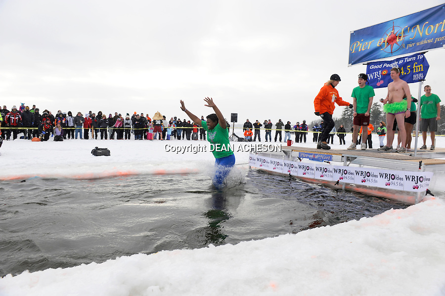 Shardaa Gray a reporter for Newswatch 12 television station in Rhinelander, WI makes her polar bear plunge in the icy waters of Big St. Germain Lake, St. Germain, WI on Saturday, Jan. 4.
