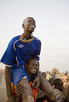 Malek Tong from Akoc Thon is carried aloft after victory over Turalei in a volleyball match at the Twic Olympics in Wunrok, Southern Sudan.