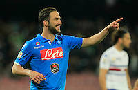 Gonzalo Higuain celebrates after scoring during the Italian Serie A soccer match between   SSC Napoli and UC Sampdoria at San Paolo  Stadium in Naples ,April 26 , 2015