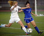 (Worcester Ma 111613) Newburyport 4, Abbie Bresnahan, with control of the ball, pursued by Granby 1, Kate Desormier,  during the MIAA State Girls Soccer Division Three final, between Newburyport High and Granby High, Newburyport won the game 1-0, Saturday at Foley Stadium in Worcester. (Jim Michaud Photo) For Sunday