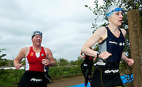 09 MAY 2010 - GRENDON, GBR - Competitors head for transition after exiting the swim during the Grendon Triathlon .(PHOTO (C) NIGEL FARROW)