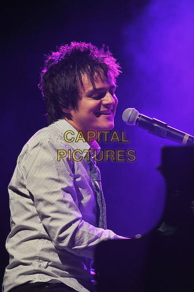 Jamie Cullum.Performing live in concert at The Forum, Kentish Town, London, England..18th October 2011.stage gig performance music in on half length grey gray shirt singing piano side sitting .CAP/MAR.© Martin Harris/Capital Pictures.