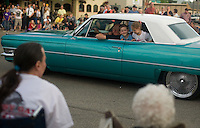 Cayley Goodman and Hunter Solis are cheufered in Junior Solis' 1964 Cadillac Convertible along Church Street in Sandpoint, ID during the 25th 'Lost in the Fifties' parade.  .. (©Matt Mills McKnight/2010)