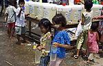 Children survivors of Cyclone Nargis hold water bottles at the town of Labutta  at  Irrawaddy Division, May 10, 2008. Despairing survivors in Myanmar awaited emergency relief on Friday, a week after 100,000 people were feared killed as the cyclone roared across the farms and villages of the low-lying Irrawaddy delta region. The storm is the most devastating one to hit Asia since 1991, when 143,000 people were killed in neighboring Bangladesh. Photo by Eyal Warshavsky  *** Local Caption *** ëì äæëåéåú ùîåøåú ìàéì åøùáñ÷é àéï ìòùåú áúîåðåú ùéîåù ììà àéùåø