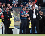 Walter Smith looks on as Archie Knox and Jim Jefferies discuss the performance of the ref as player number four is sent off in the match