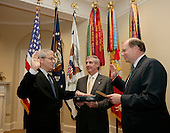 New White House Chief of Staff Josh Bolten, left, is joined by out going Chief of Staff Andrew Card, center, as Bolten is sworn-in by Deputy Chief of Staff Joe Hagin, right, Friday, April 14, 2006 in the Roosevelt Room of the White House in Washington, DC. <br /> Mandatory Credit: Paul Morse - White House via CNP