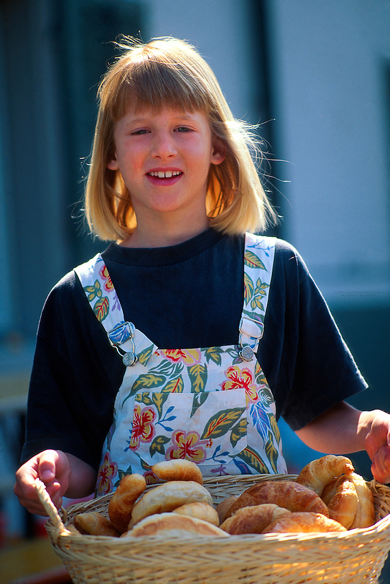 swiss girl carrying a basket of croissants thalwil switzerland