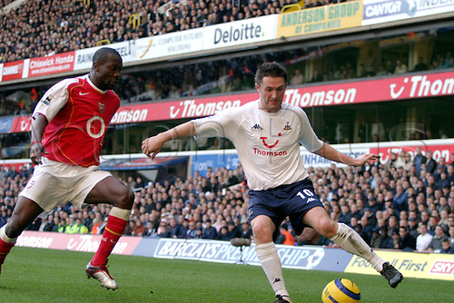 13 November 2004: Arsenal defender Lauren challenges Robbie Keane of Spurs during the Premiership match between Tottenham Hotspur and Arsenal. Arsenal won the game played at White Hart Lane 5-4. Photo: Action Plus..041113 soccer football premier league premiership player players footballer footballers