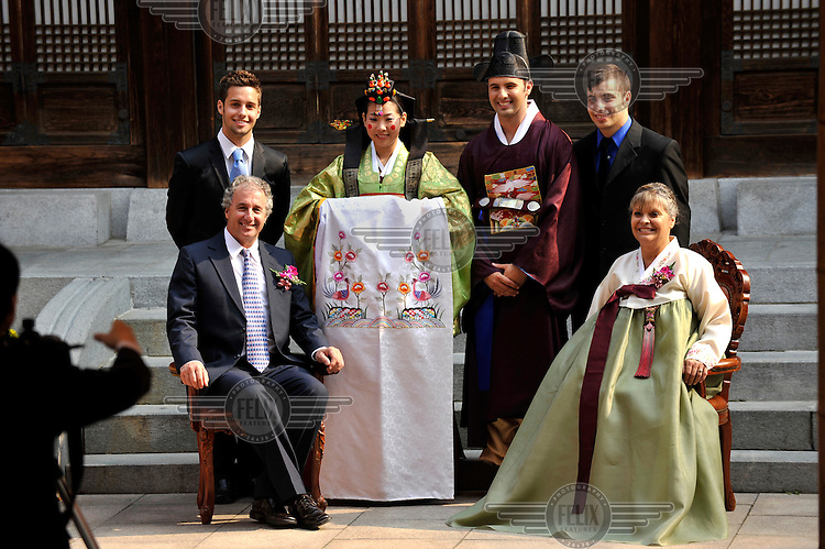 A Korean Bride And American Groom Various Family Members At Traditional