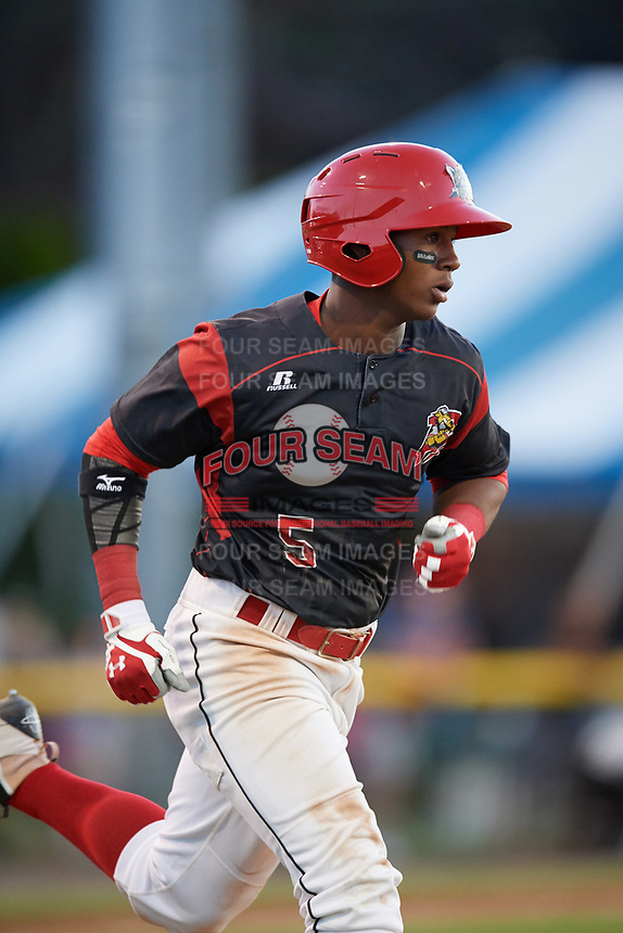Batavia Muckdogs second baseman Samuel Castro (5) runs to first base during a game against the Auburn Doubledays on June 19, 2017 at Dwyer Stadium in Batavia, New York.  Batavia defeated Auburn 8-2 in both teams opening game of the season.  (Mike Janes/Four Seam Images)