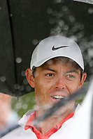 Rory McIlroy (NIR) walks the 11th hole in the rain under an umbrella during the Wednesday practice round of the 118th U.S. Open Championship at Shinnecock Hills Golf Club in Southampton, NY, USA. 13th June 2018.<br /> Picture: Golffile | Brian Spurlock<br /> <br /> <br /> All photo usage must carry mandatory copyright credit (&copy; Golffile | Brian Spurlock)
