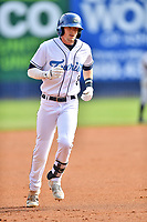 Asheville Tourists left fielder Will Golsan (8) rounds the bases after hitting a home run during game one of a double header against the Charleston RiverDogs at McCormick Field on April 9, 2019 in Asheville, North Carolina. The Tourists defeated the RiverDogs 17-3. (Tony Farlow/Four Seam Images)