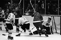 Seals score against the Philadelphia Flyers 1967.<br />Seals Ron Harris, and Joe Szura, Flyer goalie is Bernie  Parent. (photo by Ron Riesterer)