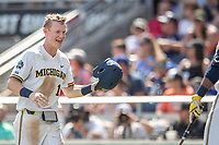 Michigan Wolverines first baseman Jimmy Kerr (15) during Game 11 of the NCAA College World Series against the Texas Tech Red Raiders on June 21, 2019 at TD Ameritrade Park in Omaha, Nebraska. Michigan defeated Texas Tech 15-3 and is headed to the CWS Finals. (Andrew Woolley/Four Seam Images)