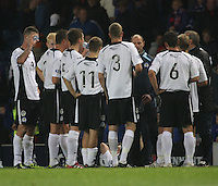 Manager Allan Johnston gives his players instructions before extra time in the Rangers v Queen of the South Quarter Final match in the Ramsdens Cup played at Ibrox Stadium, Glasgow on 18.9.12.