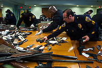 New Jersey, United States. 19th Feb, 2013 -- Police members organize weapons that were displayed to the media after being acquired during the Gun Buyback program during the last weekend in the Essex county in New Jersey. Photo by Eduardo Munoz Alvarez / VIEWpress.