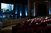 Audience members watch a video montage during a memorial service in honour of Lise Payette in Montreal, Saturday, October 20, 2018. THE CANADIAN PRESS/Graham Hughes