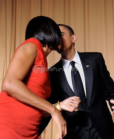 United States President Barack Obamakisses the First Lady during the White House Correspondents' Association Dinner at the Washington Hilton in Washington, DC, on Saturday, May 1, 2010.<br /> Credit: Olivier Douliery / Pool via CNP /MediaPunch