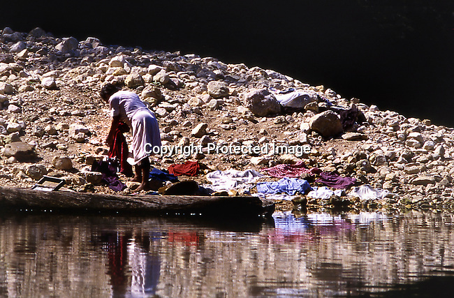 A native woman washes clothes in the Macal River, in western Belize. The locals are direct descendents of the Mayans.<br /> Photo by Mike Rynearson/Quest Imagery