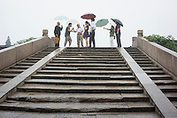 Chinese visit the ancient Qingming Bridge over the Grand Canal of China in Wuxi, Jiangsu province, in July, 2014.