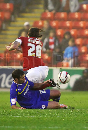 24.11.2012 Barnsley, England. Cardiff City's Simon Lappin tackles Barnsley's Jonathan Greening and receives a yellow card during the Championship game between Barnsley and Cardiff City from Oakwell. He later received a 2nd red card and was sent off on his debut