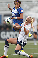 Boston Breakers forward Sydney Leroux (2) attempts to redirect a cross on net as Seattle Reign FC midfielder Kaylyn Kyle (6) defends. In a National Women's Soccer League (NWSL) match, Seattle Reign FC (white) defeated Boston Breakers (blue), 2-1, at Dilboy Stadium on June 26, 2013.