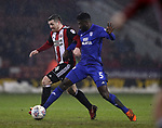 John Fleck of Sheffield Utd  and Bruno Manga of Cardiff City during the Championship match at Bramall Lane Stadium, Sheffield. Picture date 02nd April, 2018. Picture credit should read: Simon Bellis/Sportimage