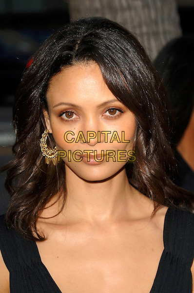 "THANDIE NEWTON.World premiere of the film ""Crash"".Held at the Samuel Goldwyn Theatre in Beverly Hills, California, USA, 26th April 2005. .portrait headshot gold dangly earrings.Ref: MOO.www.capitalpictures.com.sales@capitalpictures.com.©Capital Pictures"