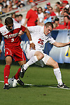 15 November 2009: NC State's Romulo Manzano (3) and Virginia's Will Bates (25) challenge for the ball. The University of Virginia Cavaliers defeated the North Carolina State University Wolfpack at WakeMed Stadium in Cary, North Carolina in the Atlantic Coast Conference Men's Soccer Tournament Championship game.