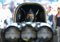 Feb. 14, 2013; Pomona, CA, USA; NHRA funny car driver Alexis DeJoria warms up her car in the pits during qualifying for the Winternationals at Auto Club Raceway at Pomona.. Mandatory Credit: Mark J. Rebilas-